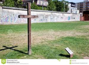 Graffiti, a cross and the Wall